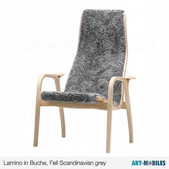Lamino Sessel von Swedese mit Lammfell offwhite